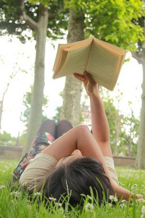 young book wyrm enjoying a book